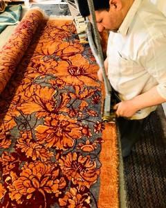 shaving the handmade rug after weaving in Farahan Carpet