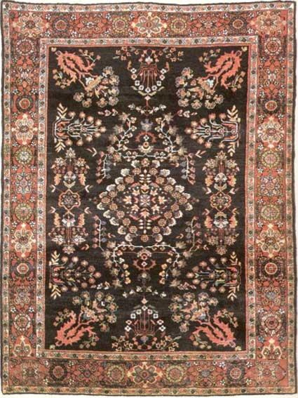 فرش دستباف فراهان با طرح دسته گلی در زمینه سرمه ای